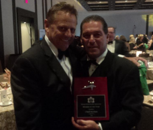 John Meinen, OHBA Past President congratulates Chuck McShane on receiving the OHBA Member of the Year Award